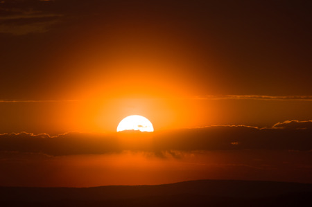 orange sunset: orange disc of the sun sinks to the horizon at sunset