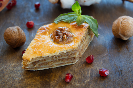 baklawa: Uzbek baklava with honey and nuts on wooden table