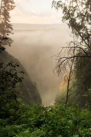 The morning mist rises over the river canyon. Landscape
