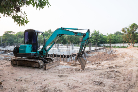 corrode: Working with machine at construction site