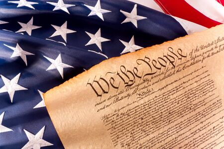 declaration: Old fashionet American Constitution with USA  Flag.
