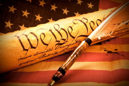 declaration: Old fashionet American Constitution - We the people  with USA Flag. Stock Photo