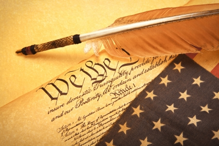 Old fashionet American Constitution - We the people  with USA Flag. photo