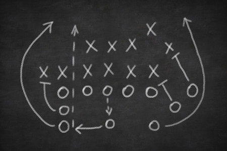 american football: Game strategy drawn with white chalk on a blackboard
