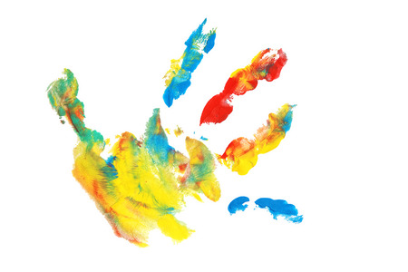Child handprints made from colorful acrylic paint on white paper