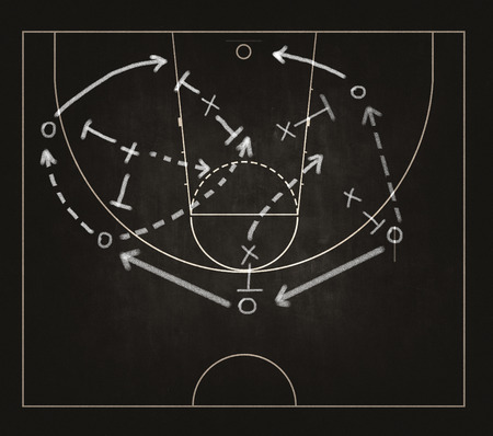 Game strategy drawn with white chalk on a blackboard. Imagens