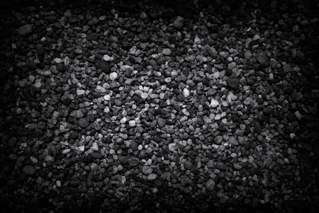 Dark concrete pebble texture, great for backgrounds.