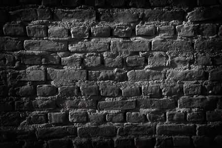 Black brick wall. Vignetting added. Great for background 免版税图像