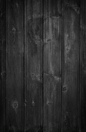 A dark grungy wooden background. Vigened added.