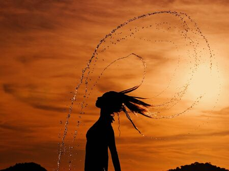 Dancing in the sunset drops. Siam bay. Province Trat. Koh Chang island. Kingdom Thailand Stock Photo