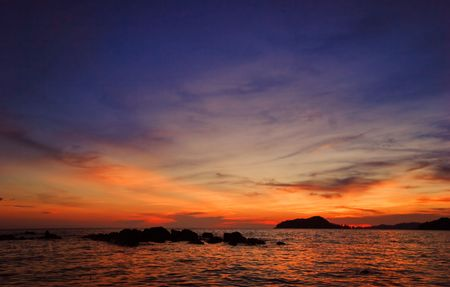 Tropical sunset on the beach of Koh Mak island. photo