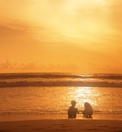 legian: Children play in the rays of the setting sun. Legian. Bali. Indonesia