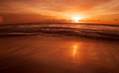Sunset on the tropical beach. Legian beach on Bali island. Indonesia