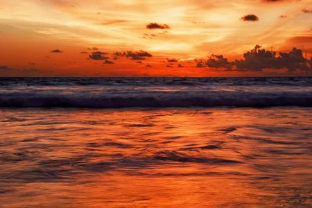 Sunset on the tropical beach. Legian beach on Bali island. Indonesia photo