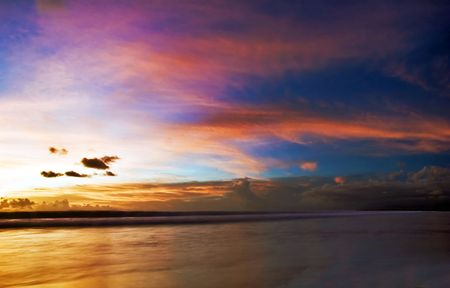 legian: Sunset on the tropical beach. Legian beach on Bali island. Indonesia Stock Photo