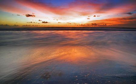 Sunset on the tropical beach. Legian beach on Bali island. Indonesia Stock Photo