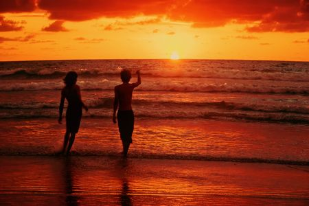 legian: Two and sunset. Children leave with Sun. Legian. Bali. Indonesia