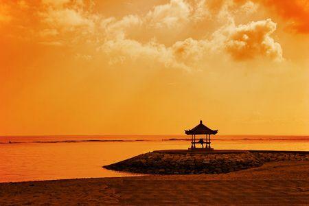 Meditation under sky of Asia. Photographed on beach Sanur. Bali island. Indonesia.
