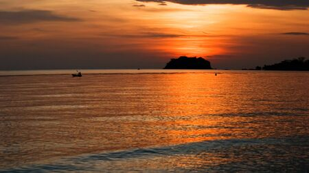 Sunset on tropical beach. Siam bay. Province Trat. Koh Chang island. Kingdom Thailand photo
