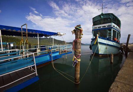 Ships near the pier. Bang Bao village. Koh Chang island. Province Trat. Thailand kingdom. photo