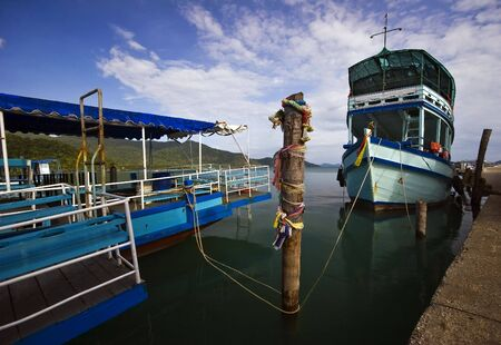 bao: Ships near the pier. Bang Bao village. Koh Chang island. Province Trat. Thailand kingdom.