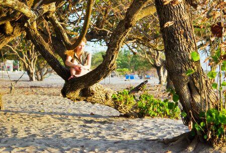 Girl on the beach. Legian beach on Bali island. Indonesia photo