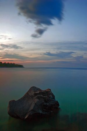 Evening at the rocky coast near the village of Amed. The island of Bali. Indonesia photo