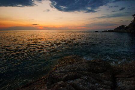 Sunset on the rocks. Siam bay. Province Trat. Koh Mak island. Kingdom Thailand photo