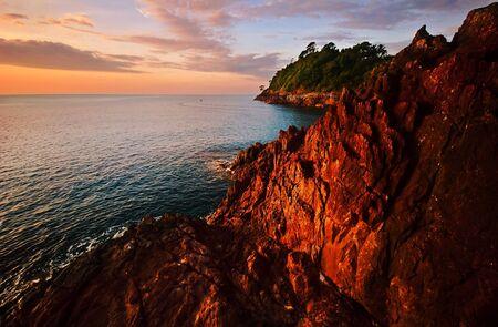 Sunset on the rocks. Siam bay. Province Trat. Koh Chang island. Kingdom Thailand photo