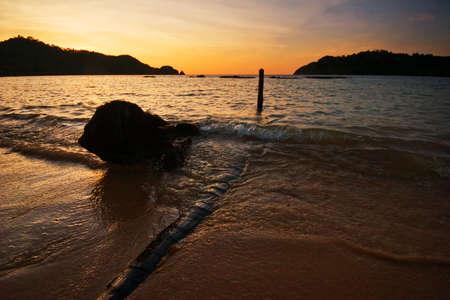 Sunset on tropical beach. Siam bay. Province Trat. Koh Chang island. Kingdom Thailand photo