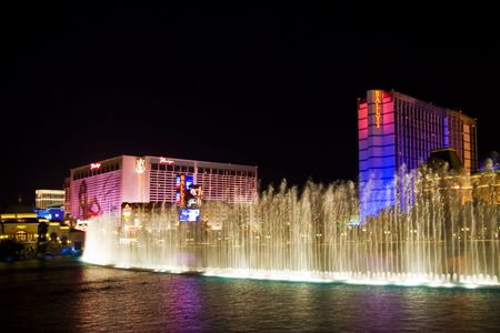 LAS VEGAS - MAY 2:Musical fountains of Bellagio Hotel on Flamingo Casino background on May 2, 2007. Editorial