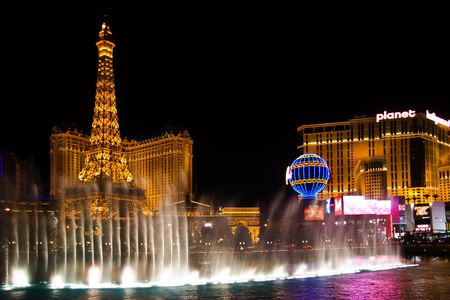 LAS VEGAS - MAY 2: The musical fountains of the Bellagio Hotel are shown in front of the Eiffel Tower of the hotel Paris May 2, 2007 in Las Vegas.