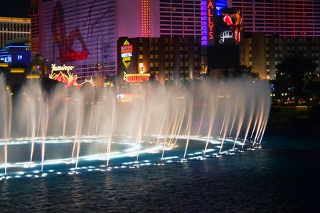 LAS VEGAS - MAY 2: Musical fountains of Bellagio on Flamingo Casino background on May 2, 2007 in Las Vegas, Nevada. The show takes place every 30 min. in the afternoons and evenings and every 15 min. from 8 to midnight