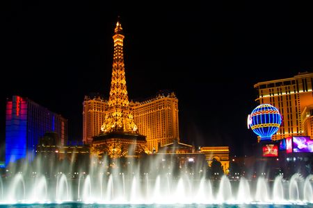 LAS VEGAS - MAY 2: The musical fountains on Eiffel Tower of Hotel Paris background on May 2, 2007 in Las Vegas, Nevada. Paris opening date was September 1, 1999. Paris cost USD $785 million to build, and occupies 24 acres