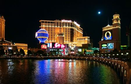 LAS VEGAS - MAY 2: The Bellagio and Planet Hollywood hotels are shown in this image taken at night on May 2, 2007 in Las Vegas, Nevada. The hotels are located along the Las Vegas strip Editorial