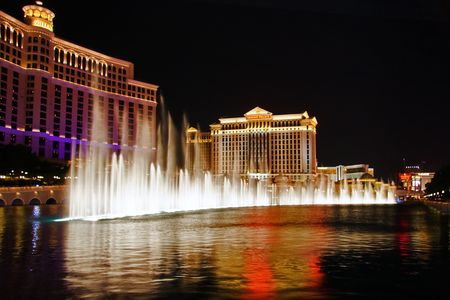 LAS VEGAS - MAY 2: The Caesars Palace Hotel is shown behind some of the fountains of the Bellagio Hotel (not shown) on May 2, 2007 in Las Vegas, Nevada. Caesars opened in 1966.