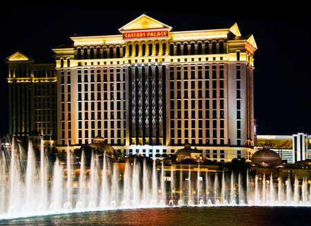 LAS VEGAS - MAY 2: The Caesars Palace Hotel is shown behind some of the fountains of the Bellagio Hotel (not shown) on May 2, 2007 in Las Vegas, Nevada. Caesars opened in 1966. Stock Photo - 6887024
