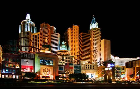 LAS VEGAS - MAY 1, 2007: Life continues at night. Illumination of New York Hotel & Casino on May 1, 2007 in Las Vegas, Nevada. The hotel skyline architecture simulates the real New York City skyline. Stock Photo - 6888117