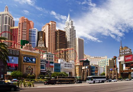 LAS VEGAS – MAY 2: Automobiles and tourist buses travel past the New York, New York Hotel & Casino on May 2, 2007 in Las Vegas. The hotel skyline architecture simulates the real New York City skyline. Stock Photo - 6887028