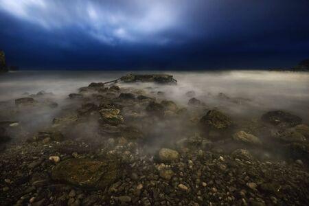 Stormy night on the stones beach. Budva. Montenegro photo