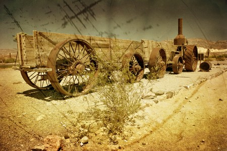 An old wagon in the Death Valley in grunge and retro style . California. United States  Stock Photo