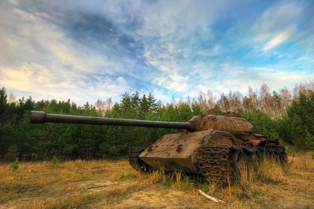 Old tank in the field  Stock Photo