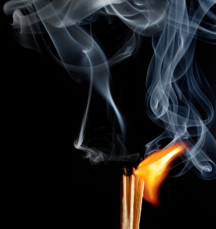 Matches with the fire and smoke photo