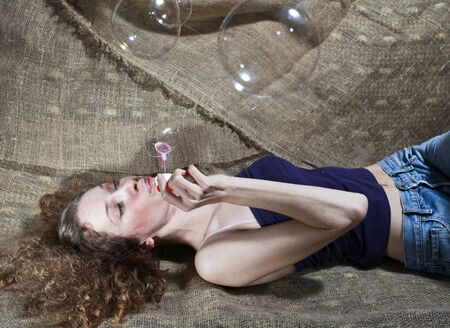 The girl inflates soap bubbles  photo
