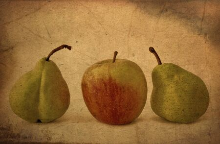 Fresh apple and pears close-up in grunge and retro style photo