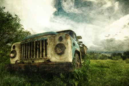 Old lorry in the field in retro style  photo