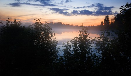 After sunset on the foggy lake  photo