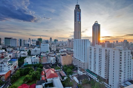 BANGKOK - JUNE 12: View on the sunrise city and Bayok Sky hotel of Bangkok on 12 June 2010. Baiyoke Sky Hotel the tallest hotel in Southeast Asia and the third-tallest all-hotel structure in the world