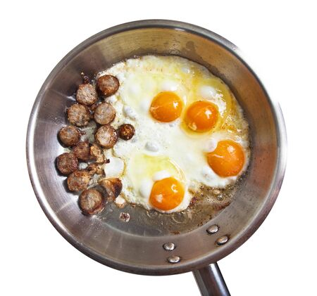 Frying pan with sausage slices and eggs  photo