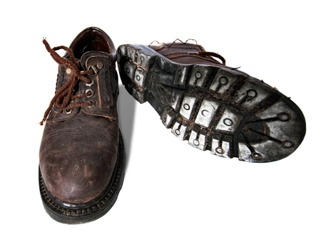 Old dirty boots on a white background  photo